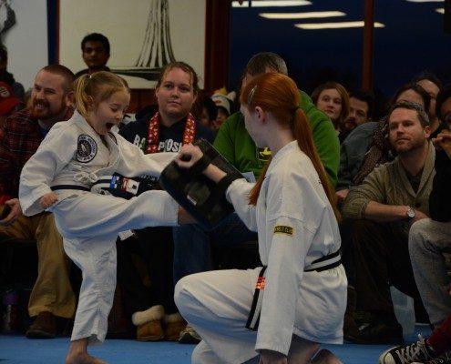 girl learning tae kwon do
