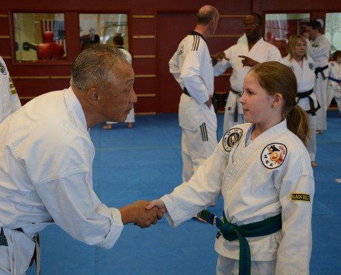 girl shaking hands accomplishment