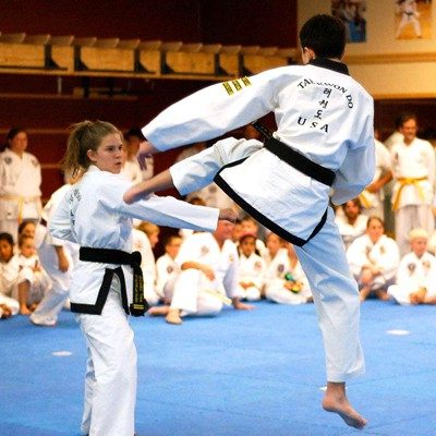 male female practicing tae kwon do