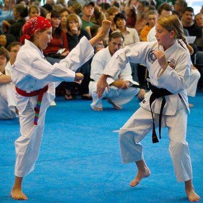 children sparring high kicks