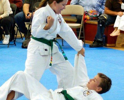 girl take down boy martial arts