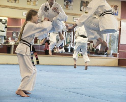 kids teens tae kwon do jumping high off mat