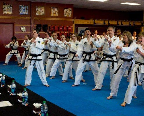 black belt students group photo shout