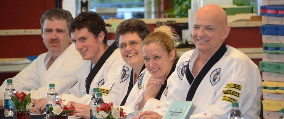 judges smiling martial arts belts