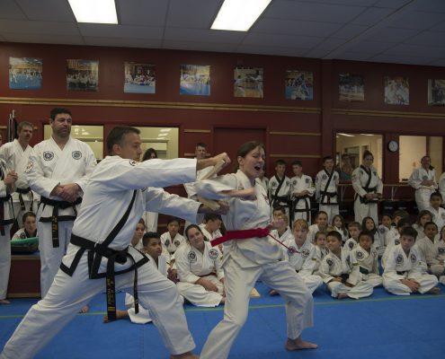 Asheville artist breaks boards at martial arts testing