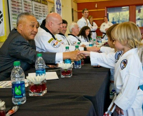 Child Shaking Hands With Tae Kwon Do Instructor Asheville Sun Soo Martial Arts
