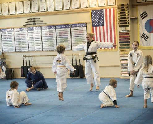 children martial arts class jumping joy