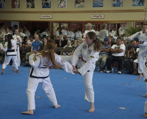 teen girl practices martial arts techniques
