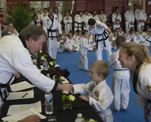 young boy meets tae kwon do guest master instructor - Copy