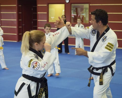 kids learning from teacher karate