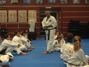 Grandmaster Suk Jun Kim teaches students at Asheville Sun Soo Martial Arts
