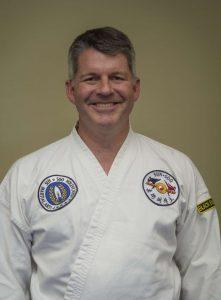Photo of Gren Clark, new 1st Dan Black Belt