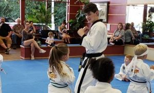 Master Ian Dowling helps teach TKD to preschoolers