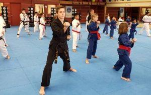 Mister Matt Gaddy assisting with Advanced Kids Taekwondo classes