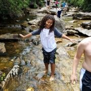Child walking in river during field trip