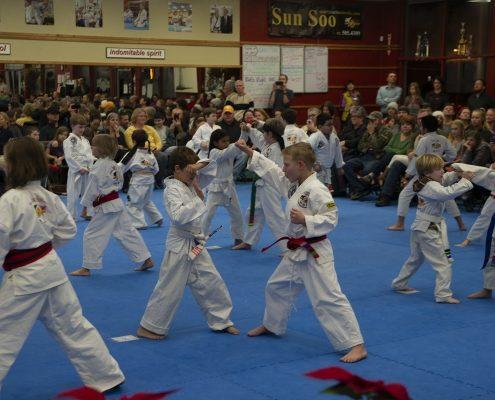 photo of children practicing self defense techniques using taekwondo
