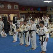 photo of kids who are ranked black belts in traditional taekwondo participating in a tournament in asheville