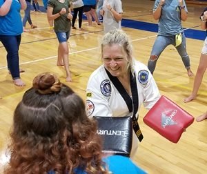 Photo of female martial arts instructor teaching self-defense techniques