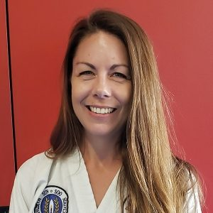 Photo of Jessica Tripp, Executive Director of Serve to LEAD and 1st Degree Black Belt at Asheville Sun Soo Martial Arts