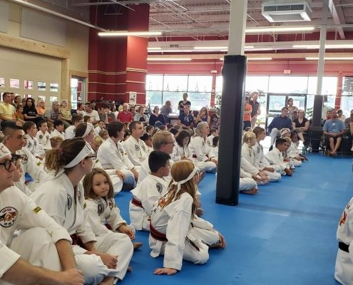 Taekwondo students seated at testing event