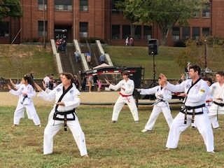 Taekwondo practitioners of various ages demonstrate forms