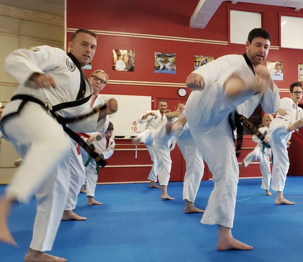 Martial arts students practicing drills